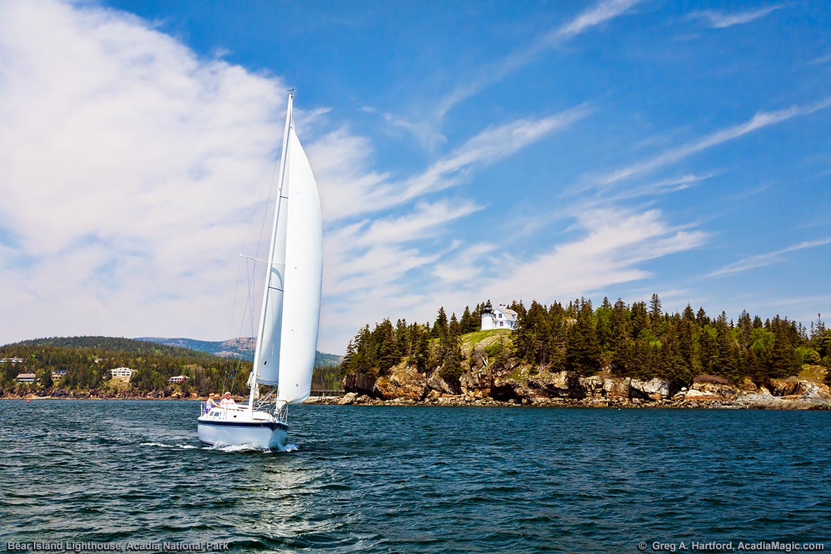 A sailboat exits Somes Sound at the southern end of Mount Desert Island in Maine.
