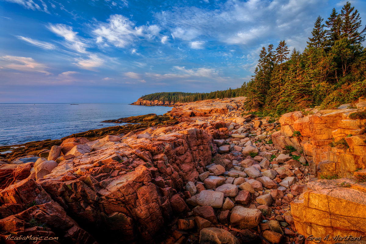 Sunrise on the eastern side of Mount Desert Island in Acadia National Park showing Otter Cliff