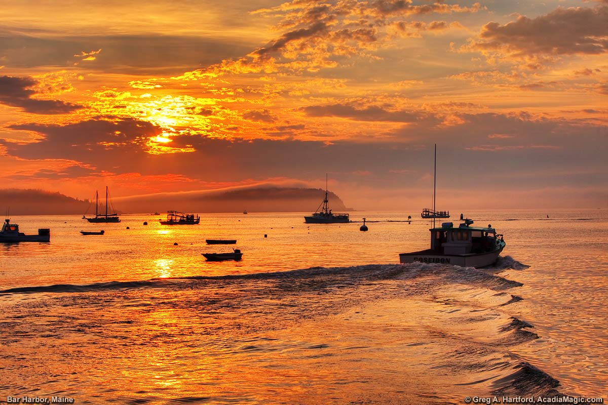 Lobster Boat leaving harbor at sunrise in Bar Harbor, Maine
