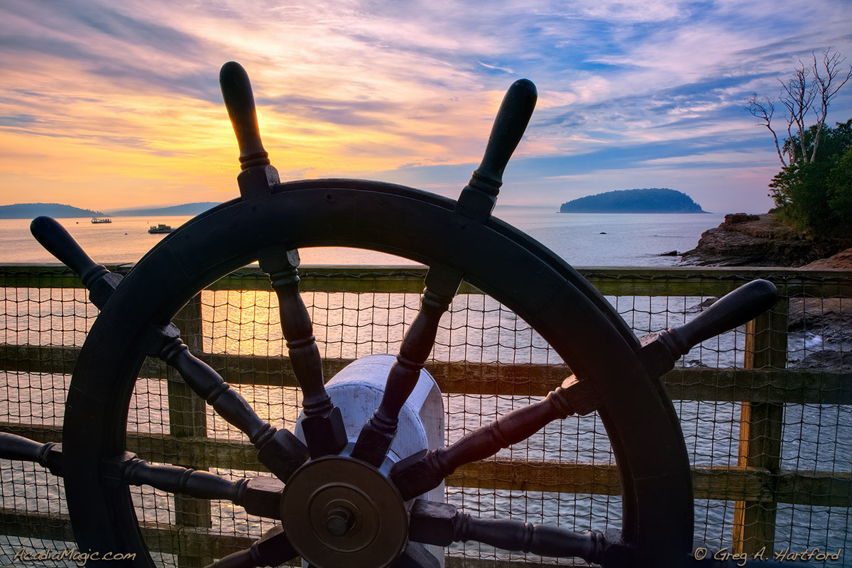 Ship navigation wheel at sunrise in Bar Harbor, Maine