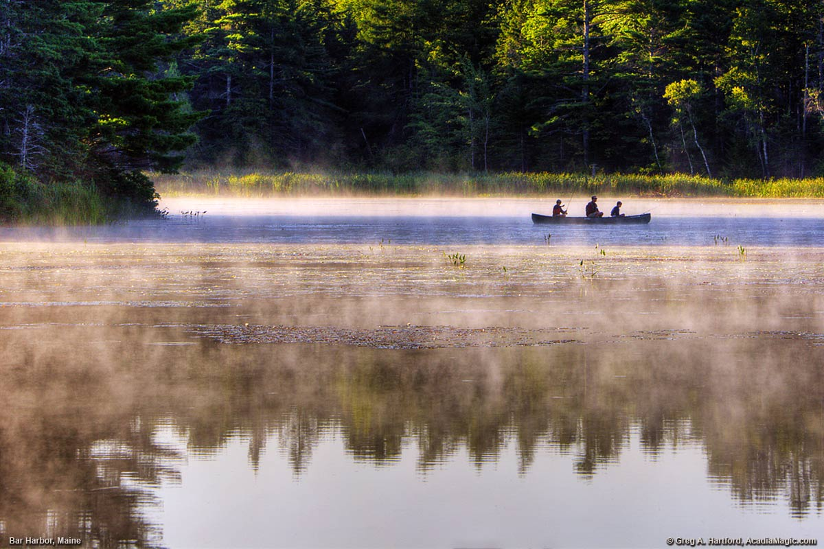 A father and his sons fish on Hamilton Pond in Bar Harbor, Maine.