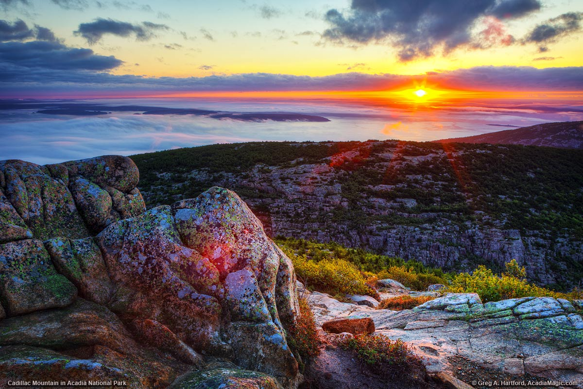 Sunrises over Dorr Mountain seen from Cadillac Mountain in Acadia