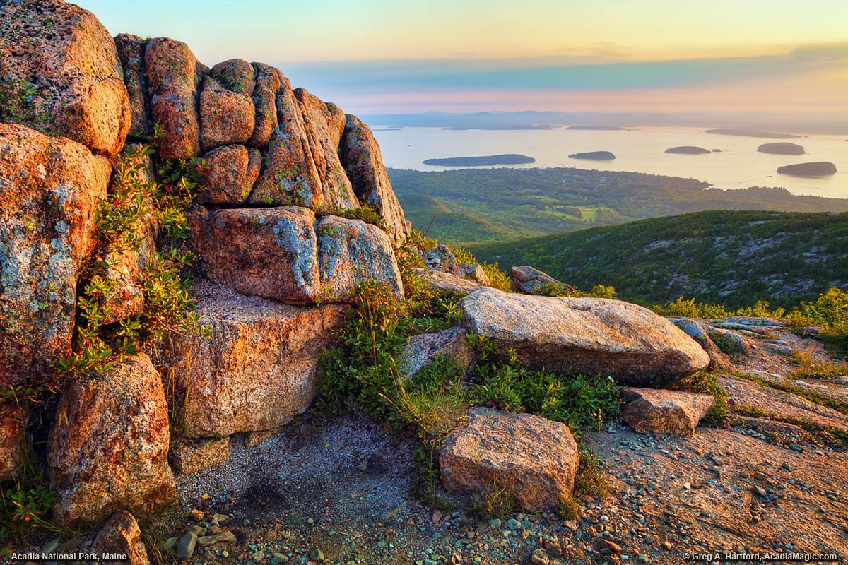 A soft and mellow sunrise seen from Cadillac Mountain