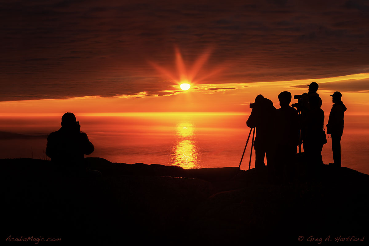 Photographers capture the first light of a Cadillac Mountain sunrise in Acadia National Park.