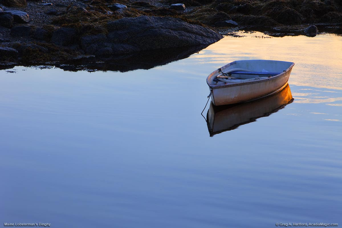 A lone lobster man's dinghy sits in a Maine harbor.