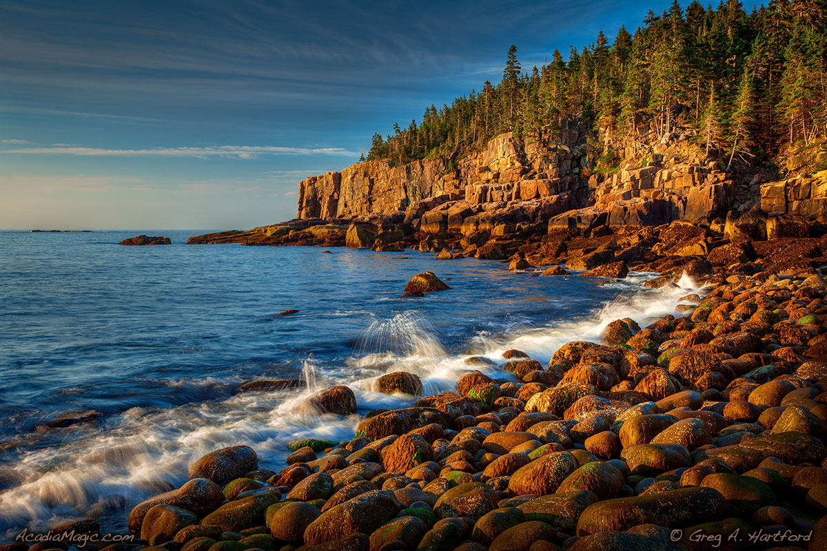 A view of Otter Cliff on calm morning in Acadia National Park