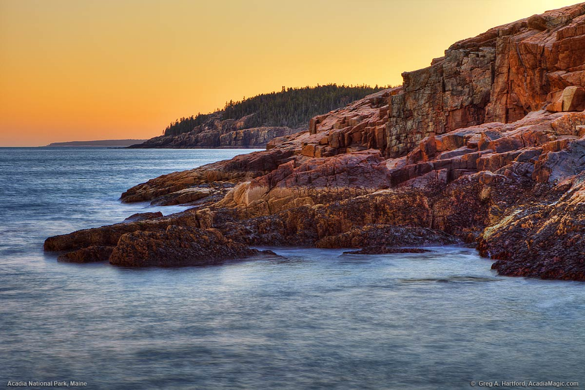A view of Otter Cliff from just north on the rocky coast in Acadia National Park