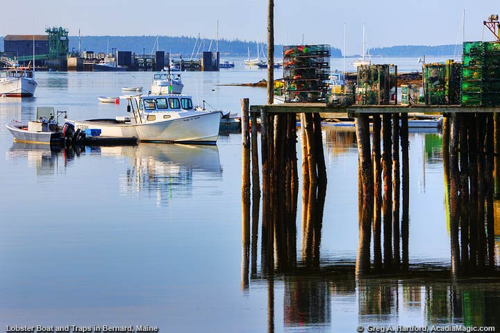 View photo of Maine lobster boat, lobster traps, and view of Bass Harbor, Maine.