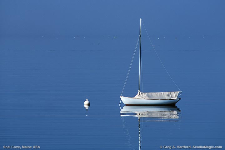 Sailboat with reflection in ocean