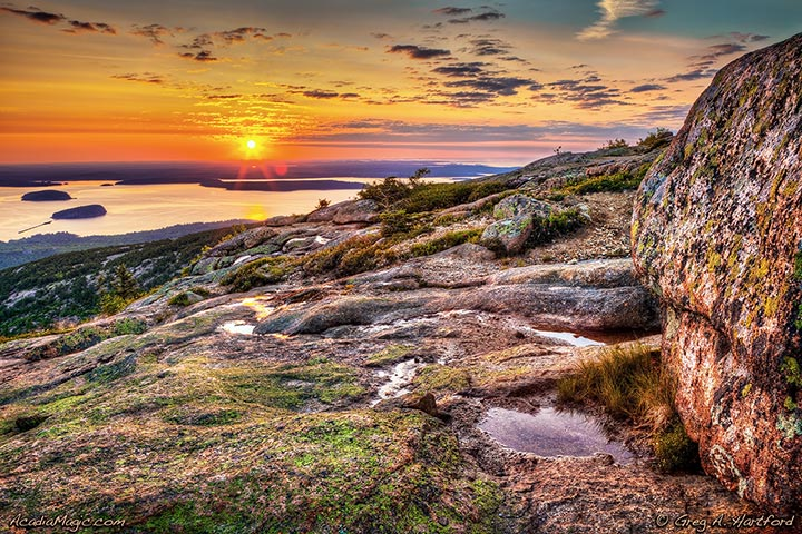 Golden sunrise over Schoodic Peninsula seen from Cadillac Mountain