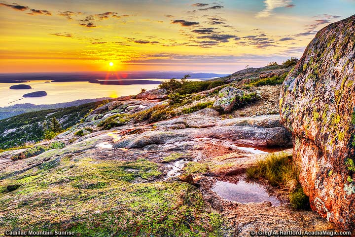 A beautiful golden sunset on Cadillac Mountain looking over Bar Harbor