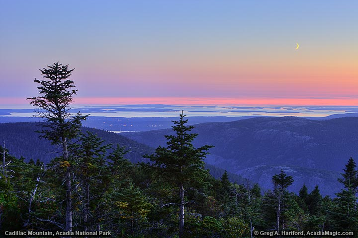 Twilight view of Southwest Harbor from cadillac Mountain with setting moon