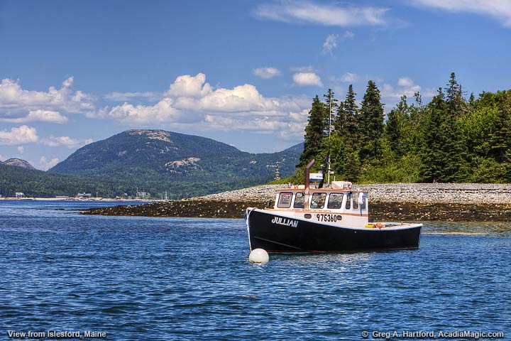 Lobster boat with Mount Desert Island in background