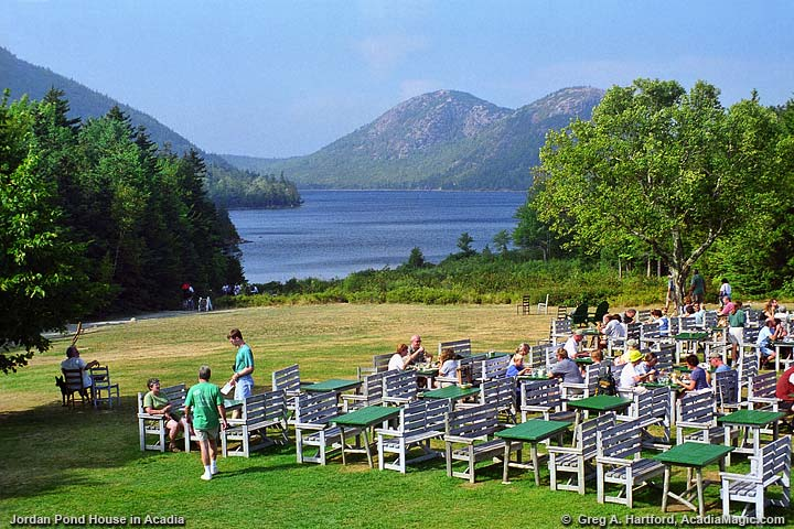 View of Park visitors dining on the lawn at the Jordan Pond House