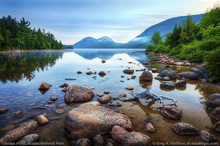 Jordan Pond with reflections of mountains in the water