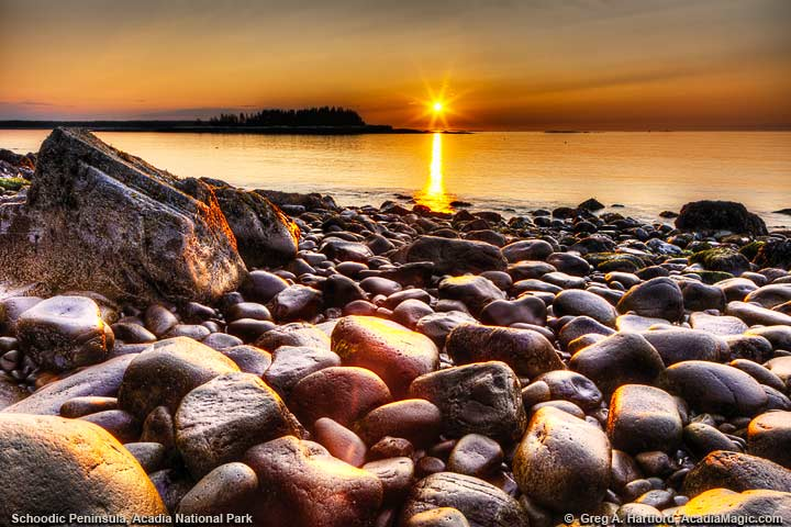 Beautiful golden sunrise with large boulders in foreground