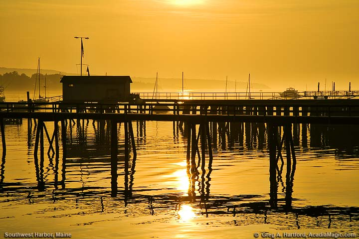Reflections at pier with sunrise