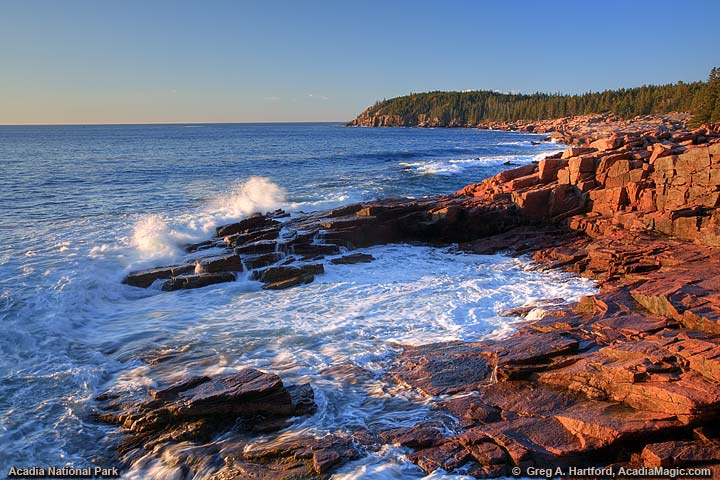 Sunrise view of Otter Cliff seen from Thunder Hole in Acadia