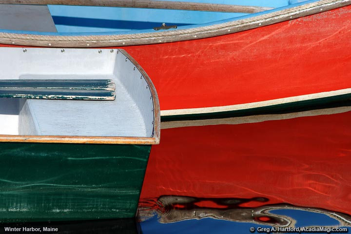 Interesting composition using red dinghy and reflections
