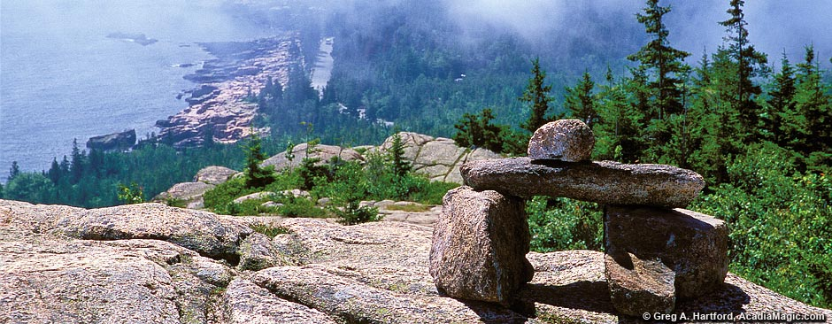 This shows a hiking trail cairn on top of Gorham Mountain in Acadia National Park.